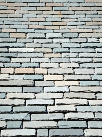 colored slate shingles on a sunny rooftop
